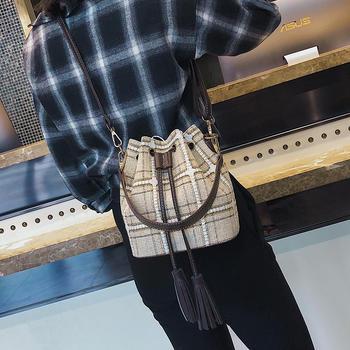 莫妮卡时尚水桶流苏斜挎包单肩包